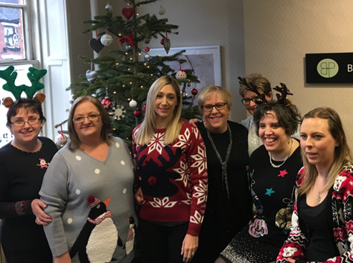 Bowcock & Pursaill staff in their Christmas jumpers